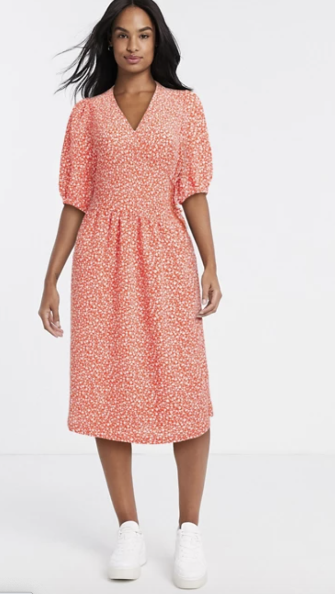 PHOTO: ASOS. Monki Yoana recycled polyester floral print puff short sleeve tie wrap dress in red