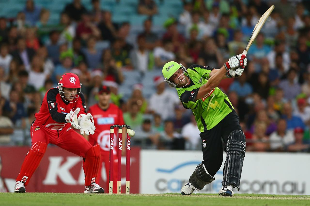 SYDNEY, AUSTRALIA - DECEMBER 14:  Chris Tremain of the Thunder bats during the Big Bash League match between the Sydney Thunder and the Melbourne Renegades at ANZ Stadium on December 14, 2012 in Sydney, Australia.  (Photo by Mark Kolbe/Getty Images)
