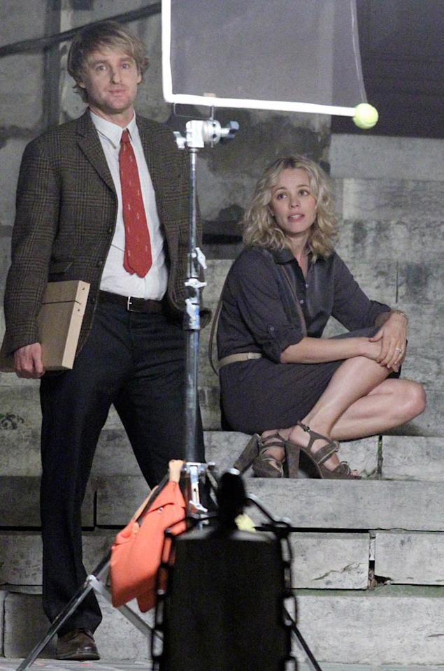 """Rumors are swirling Owen Wilson and his """"Wedding Crashers"""" co-star Rachel McAdams, who are working together again on Woody Allen's """"Midnight in Paris,"""" are now hooking up. A source tells <i>The Sun</i>, """"Owen was playing with her hair and being very affectionate ... very flirtatious,"""" after the cameras stopped rolling. So are the on-screen stars an off-screen couple? See <a href=""""http://www.gossipcop.com/owen-wilson-dating-rachel-mcadams-couple-midnight-paris/"""" target=""""new"""">Gossip Cop</a> for the inside dish. KCSPresse/<a href=""""http://www.splashnewsonline.com"""" target=""""new"""">Splash News</a> - July 29, 2010"""