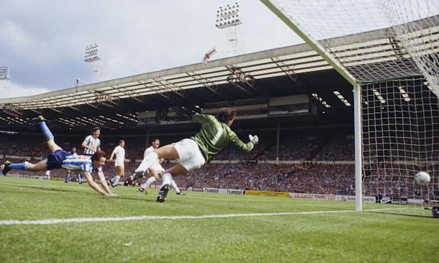 """<span class=""""element-image__caption"""">Keith Houchen heads home Coventry City's second equaliser past the Tottenham Hotspur goalkeeper Ray Clemence during the 1987 FA Cup final at Wembley. </span> <span class=""""element-image__credit"""">Photograph: David Cannon/Getty Images</span>"""