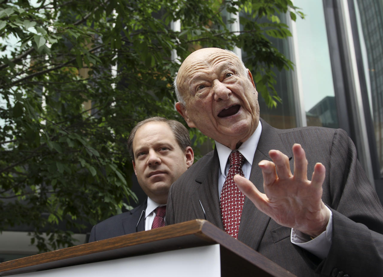 FILE - In this May 16, 2012, file photo, former New York Mayor Ed Koch, right, talks to reporters as Assemblyman Rory Lancman watches in New York. Koch, the combative politician who rescued the city from near-financial ruin during three City Hall terms, has died at age 88. Spokesman George Arzt says Koch died Friday morning Feb. 1, 2013 of congestive heart failure. (AP Photo/Frank Franklin II, File) (AP Photo/Seth Wenig, File)