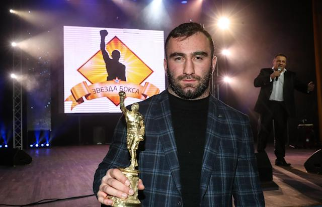 Boxer Murat Gassiev holds a trophy for the Best Bout at the 2017 Boxing Star awards ceremony at the Golden Palace entertainment centre. (Getty)