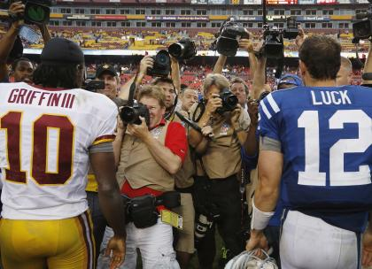 Robert Griffin III and Andrew Luck after their NFL preseason football game in Landover, Maryland August 25, 2012. (REUTERS/Jonathan Ernst)