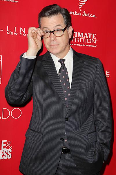 """FILE - This Jan. 31, 2014 file image released by Starpix shows Stephen Colbert at the Shape Magazine and Men's Fitness Super Bowl Party in New York. Comedy Central deleted a message Thursday from the """"Colbert Report"""" show Twitter feed showing a still from Wednesday night's show where Colbert had joked about starting a """"Ching-Chong Ding-Dong Foundation for Sensitivity to Orientals or Whatever."""" It was part of a skit where Colbert had talked about the Washington Redskins owner buying things for Native Americans upset with the team's name. (AP Photo/Starpix, Amanda Schwab, File)"""