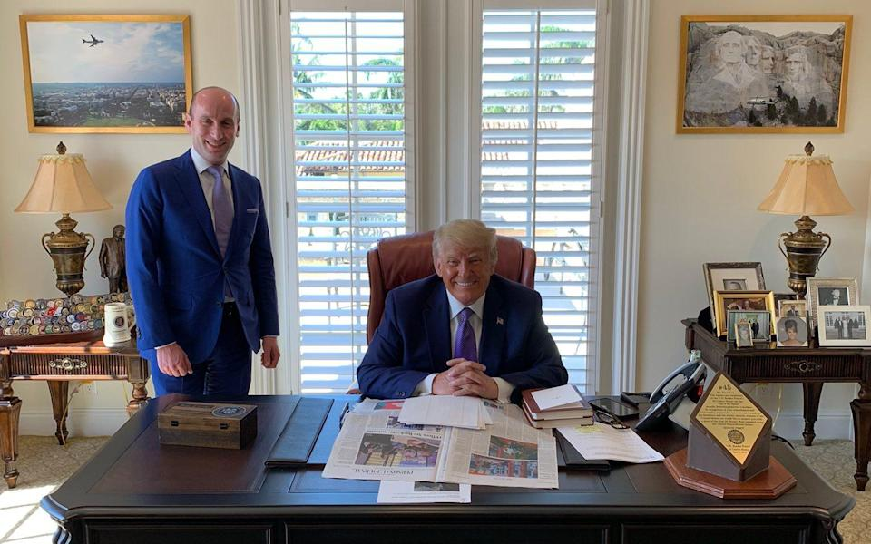 Donald Trump occupies his own version of the White House's famous Resolute Desk at his Mar-a-Lago resort