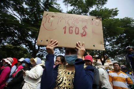File photo of a garment worker holding a placard during a protest in central Phnom Penh