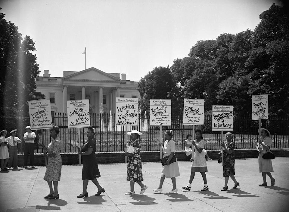 """<p>Women peacefully protested against lynching in front of the White House. Their signs stated """"Stop Lynching Let Real Democracy Prevail"""" and """"Lynching is Disgraceful Let's Stop It."""" </p>"""
