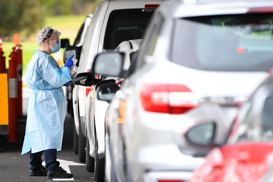 Cars line up at a coronavirus testing clinic in Melbourne.