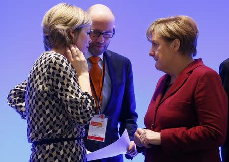 Germany's Christian Democratic Union (CDU) deputy head Julia Kloeckner, secretary general Peter Tauber and party leader Chancellor Angela Merkel (L-R) speak during their meeting in Karlsruhe, December 13, 2015. CDU will hold a two-day congress in Karlsruhe on Monday.    REUTERS/Ralph Orlowski