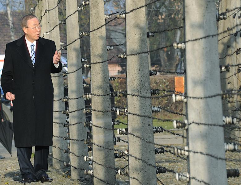 United Nations Secretary General Ban Ki-moon walks along a barbed-wire fence as he visits the former German Nazi Death Camp Auschwitz-Birkenau, in Oswiecim, Poland, Monday, Nov. 18, 2013. Ban Ki-moon will attend the U.N. Climate Conference held in Warsaw. on Tuesday (AP Photo/Alik Keplicz)