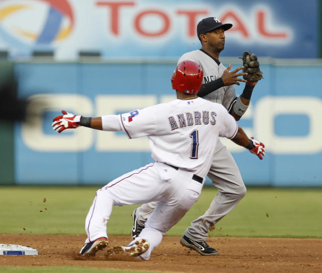 New York Yankees shortstop Eduardo Nunez steps away after forcing out Texas Rangers' Elvis Andrus during the third inning of a baseball game, Wednesday, July 24, 2013, in Arlington, Texas. Nelson Cruz was safe at first. (AP Photo/Jim Cowsert)