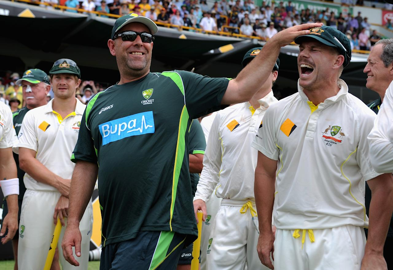 PERTH, AUSTRALIA - DECEMBER 17:  Australian coach Darren Lehmann shares a joke with David Warner of Australia after winning the Third Ashes Test Match between Australia and England at WACA on December 17, 2013 in Perth, Australia.  (Photo by Gareth Copley/Getty Images)