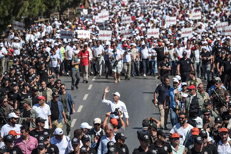 "Turkey's government has dismissed opposition leader Kemal Kilicdaroglu's ""March for Justice"" as an irritation -- but tens of thousands have turned out to support him along the way (AFP Photo/OZAN KOSE)"