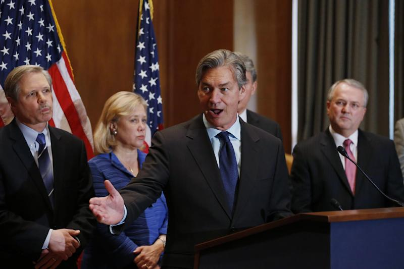 Canada's Ambassador to the US Gary Doer, center, stands with, from left, Sen. John Hoeven, R-N.D., Sen. Mary Landrieu, D-La., and American Petroleum Institute (API) President and CEO Jack N. Gerard and at a news conference on Capitol Hill in Washington, Tuesday, Feb. 4, 2014, regarding the approval of the Keystone XL pipeline. (AP Photo/Charles Dharapak)