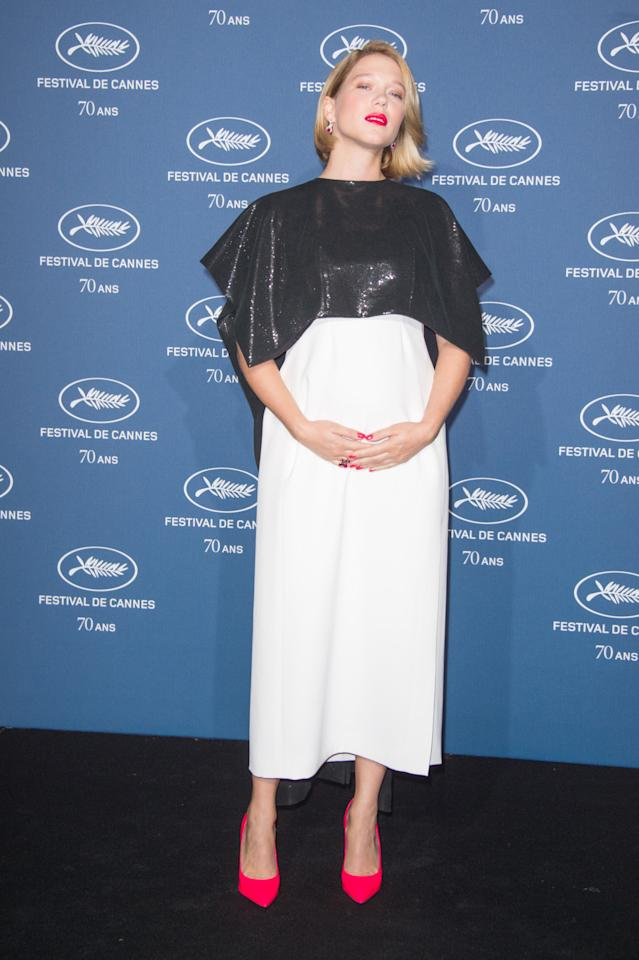 <p>There's no shortage of celebrities looking better than ever while pregnant currently. Bond girl Lea worked a fantastic monochrome dress, featuring a crop top and a cape, and finished off the look with bright pink lipstick and matching heels.<i> [Photo: Getty]</i></p>