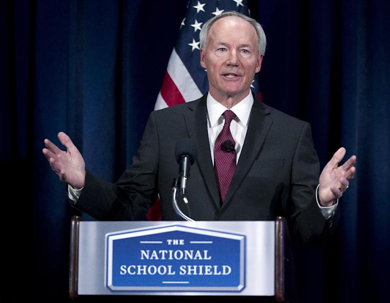 National School Shield Task Force Director, former Arkansas Rep. Asa Hutchinson gestures during a news conference at National Press Club in Washington, Tuesday, April 2, 2013, to discuss his groups's school-guns study. The National Rifle Association's study recommends schools across the nation each train and arm at least one staff member.  (AP Photo/Jose Luis Magana)