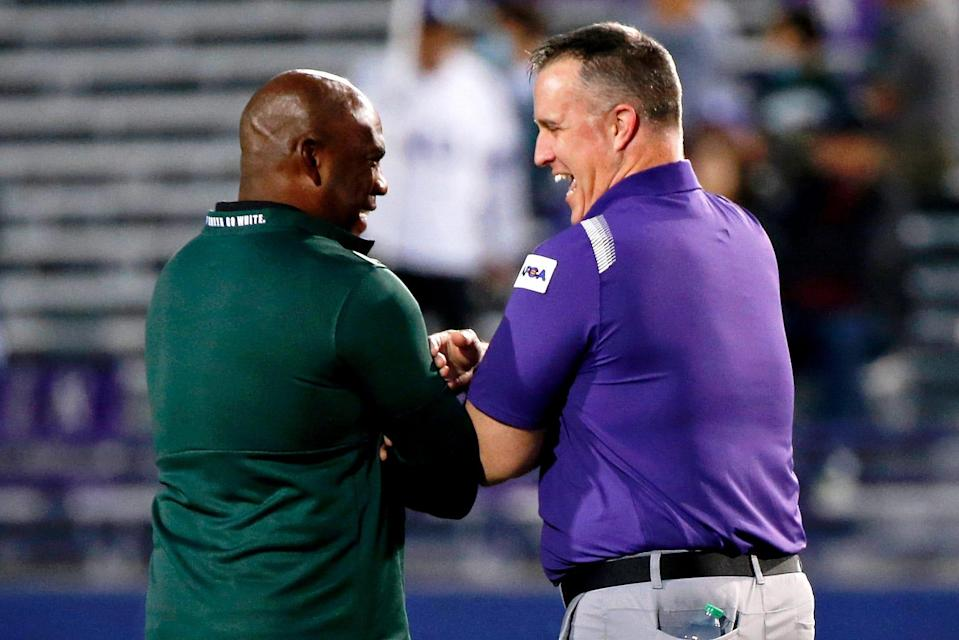 Michigan State coach Mel Tucker and Northwestern coach Pat Fitzgerald talk before the game on Friday, Sept. 3, 2021, in Evanston, Illinois.