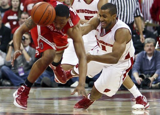 Wisconsin's Jordan Taylor, right, fouls Ohio State's Lenzelle Smith during the first half of an NCAA college basketball game Saturday, Feb. 4, 2012, in Madison, Wis. (AP Photo/Andy Manis)