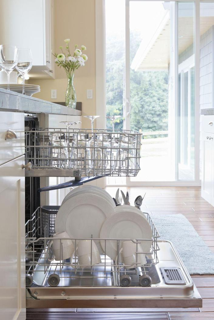 """<p>Just like the other appliances in your home, dishwashers require regular cleaning. <em>Good Housekeeping</em> recommends <a href=""""https://www.countryliving.com/home-maintenance/cleaning/a27471775/how-to-clean-dishwasher/"""" rel=""""nofollow noopener"""" target=""""_blank"""" data-ylk=""""slk:giving your dishwasher a deep clean"""" class=""""link rapid-noclick-resp"""">giving your dishwasher a deep clean</a> — including an alkaline wash and drain trap scrub — once a month. One way to do this is to fill a dishwasher-safe cup or bowl with white vinegar and place it on <br>the upper rack of your dishwasher. Afterwards, run the (otherwise-empty) dishwasher on the hottest setting. If you don't like the smell of vinegar, you can also opt to sprinkle one cup of baking soda along the bottom of your dishwasher and rinse on a hot-water cycle instead.</p><p>To clean your drain trap, remove and disassemble it and — once it's apart — use a sponge or toothbrush and dish soap to remove any stuck-on food bits or mold.<br></p>"""