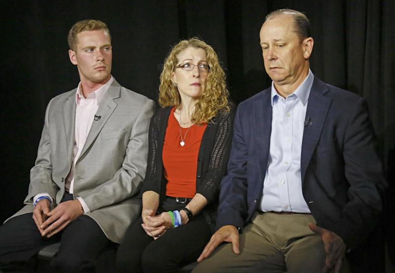 James Piazza, right, seated with his wife Evelyn, center, and son Michael, left, holds back emotions while discussing the death of his son, (AP Photo/Bebeto Matthews)