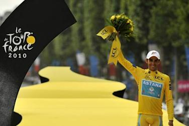 Photo 1 - Tour De France Winner Alberto Contador From Spain Celebrating His AFP/Getty Images