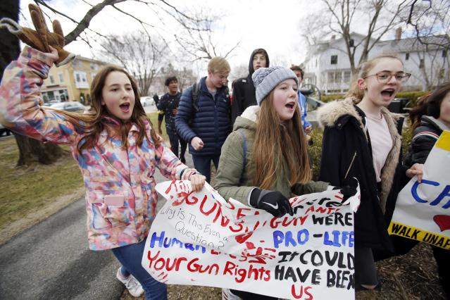 <p>Students and teachers from grades 6 to 8 leave the Berkshire Country Day School campus in Stockbridge and walk to downtown Lenox, chanting and holding signs against gun violence, Friday, April 20, 2018, as they taking part in a national school walkout event to protest gun violence. (Photo: Stephanie Zollshan/The Berkshire Eagle via AP) </p>