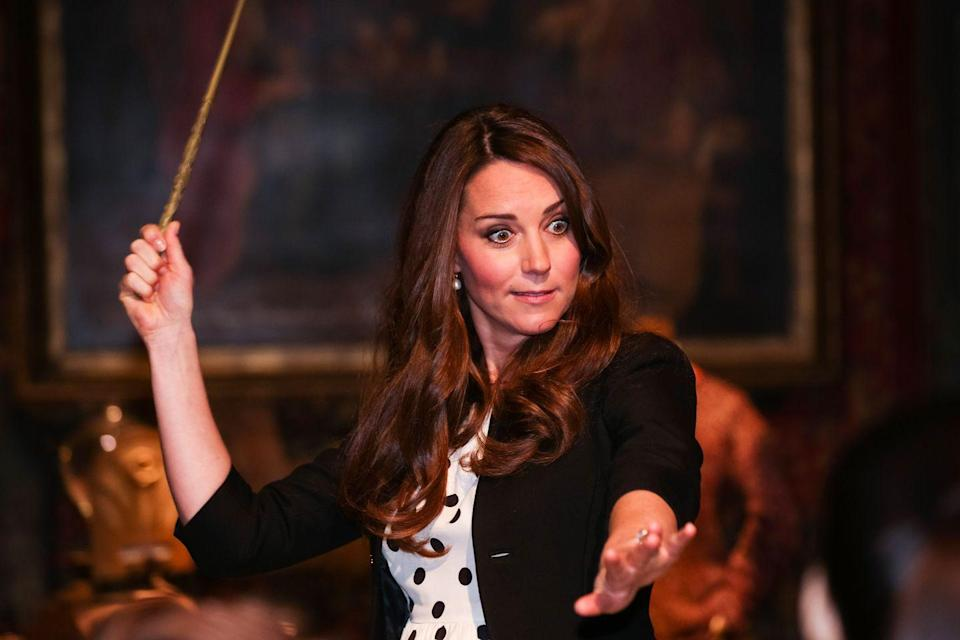 """<p>Looks like even the royals are fans of <em>Harry Potter</em>! During the Inauguration of Warner Bros. Studios Leavesden, Kate waved a wand on the set of Diagon Alley. Think she was explaining the proper way to pronounce """"Wingardium Leviosa""""?</p>"""