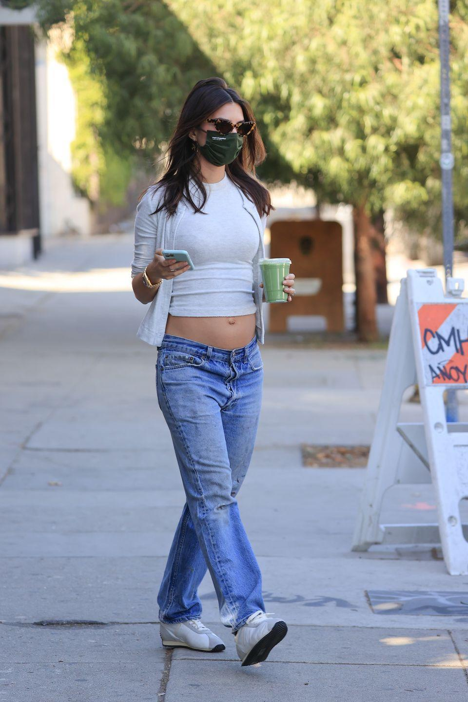 <p>The model was spotted picking up a green juice in Los Angeles in a low-key maternity look where she bared her bump in a pair of low-slung jeans, a T-shirt and matching cardigan. </p>