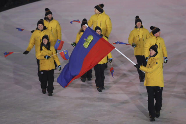 <p>Marco Pfiffner carries the flag of Liechtenstein during the opening ceremony of the 2018 Winter Olympics in Pyeongchang, South Korea, Friday, Feb. 9, 2018. (AP Photo/Michael Sohn) </p>
