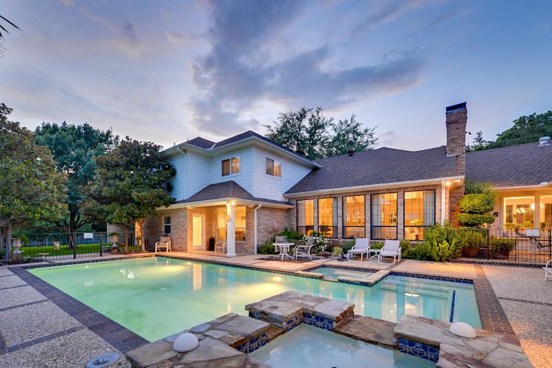 "This July 15, 2013 photo, courtesy of Rogers Healy and Associates Real Estate shows the rear of the home featured as Texas Ranger Cordell Walker's house from the former television series ""Walker, Texas Ranger,"" in Dallas. Rogers Healy, of Rogers Healy and Associates Real Estate has listed the 7,362-square-foot home for $1.2 million. The seven-bathroom and four-bedroom has been extensively renovated since the show ended in 2001. (AP Photo/Rogers Healy and Associates Real Estate)"