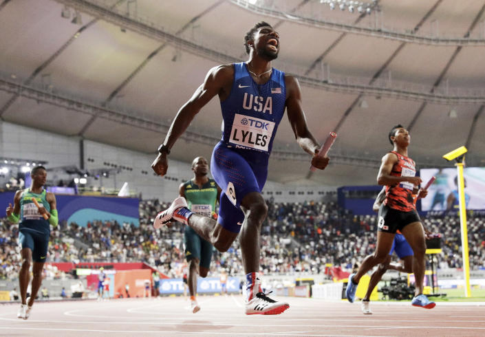FILE - In this Oct. 5, 2019, file photo, Noah Lyles, of the United States, leads the team to gold in the men's 4x100 meter relay final at the World Athletics Championships in Doha, Qatar. Lyles is spending his time these days trying to process what's happening in his country — a land riven with protests, pain and questions in the aftermath of the killing of George Floyd. (AP Photo/Petr David Josek, FIle)