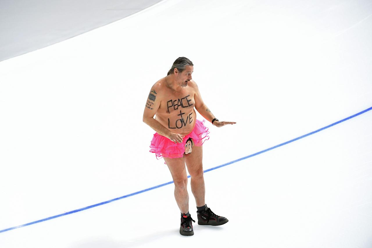 <p>A shirtless man clad in a tutu dances on the rink following the men's 1,000m speed skating event medal ceremony during the Pyeongchang 2018 Winter Olympic Games at the Gangneung Oval in Gangneung on February 23, 2018. / AFP PHOTO / Roberto SCHMIDT </p>