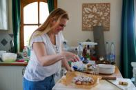 Eszter Harmath prepares a cake at home, during COVID-19 pandemic, in Szentendre