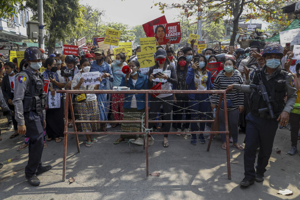 Demonstrators protest against the military junta's arrest and chagrining of National League for Democracy party lawmakers, Mandalay region Chief Minister Zaw Myint Maung and Mayor Ye Lwin, outside Aung Myay Thar Zan Township court in Mandalay, Myanmar, Thursday, Feb. 18, 2021. Tens of thousands of demonstrators flooded the streets of Myanmar's biggest city, Yangon, Wednesday, in one of largest protests yet of a coup, despite warnings from a U.N. human rights expert that recent troop movements could indicate the military was planning a violent crackdown. (AP Photo)