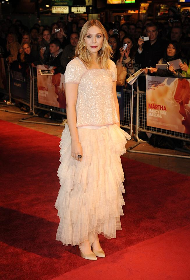 """Elizabeth Olsen fails to impress with this frumpy Chanel Spring 2012 couture dress at the 55th Annual BFI London Film Festival premiere of """"Martha Marcy May Marlene"""" on October 23, 2011."""