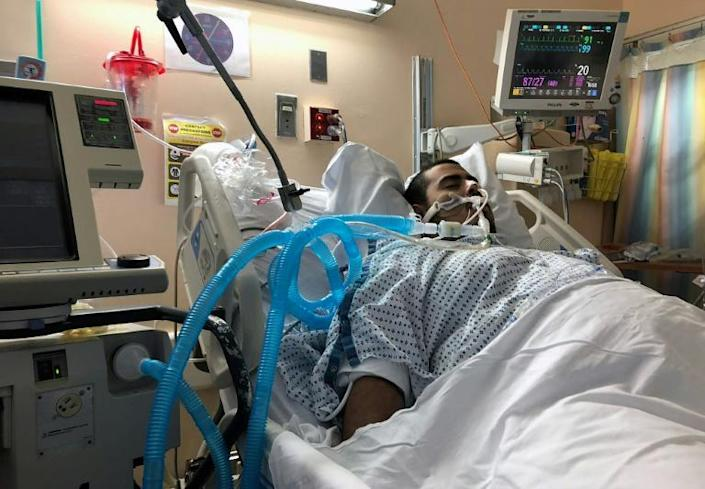 """This undated family photo shows Gregory Rodriguez at a hospital in New York. The doctor who treated him said he was """"within hours of dying"""" (AFP Photo/HO)"""