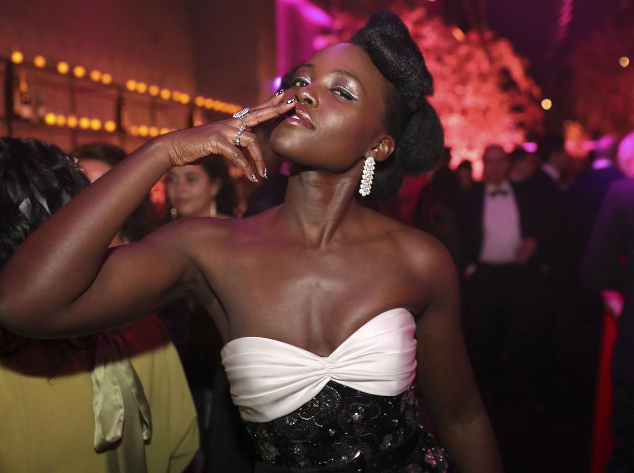 Lupita Nyong'o strikes a pose (and looks incredibly glam while she does it).