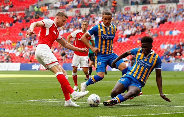 "Soccer Football - League One Play-Off Final - Rotherham United v Shrewsbury Town - Wembley Stadium, London, Britain - May 27, 2018 Rotherham's Michael Smith in action with Shrewsbury Town's Aristote Nsiala Action Images/Jason Cairnduff EDITORIAL USE ONLY. No use with unauthorized audio, video, data, fixture lists, club/league logos or ""live"" services. Online in-match use limited to 75 images, no video emulation. No use in betting, games or single club/league/player publications. Please contact your account representative for further details."