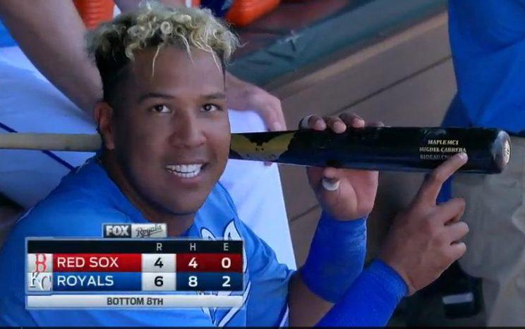 Salvador Perez shows off the Miguel Cabrera bat he used to hit Wednesday's game-winning grand slam. (MLB.TV)