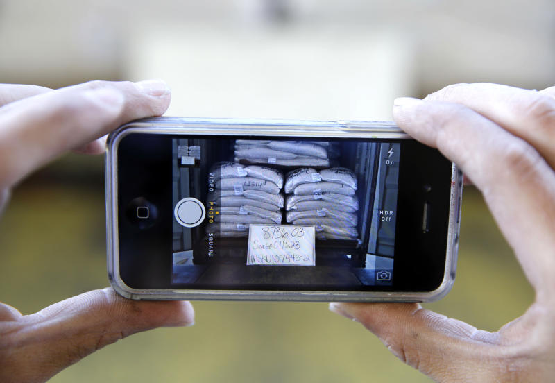 In this Tuesday, Sept. 24, 2013 photo, a load of almonds is photographed with the shipping information before the truck is closed and sealed and leaves Hughson Nut, Inc., in Livingston, Calif. Hughson has joined a growing number of companies that have become victims of an increasingly common form of commercial identity theft that has allowed con men to make off each year with millions of dollars in merchandise. Thieves, posing as truckers, load freight onto their own tractor-trailers and drive away. (AP Photo/Rich Pedroncelli)