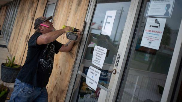 PHOTO: Local resident Robert Sawyer, 48, boards up businesses ahead of Hurricane Laura in Galveston, Texas, Aug. 26, 2020. (Adrees Latif/Reuters)