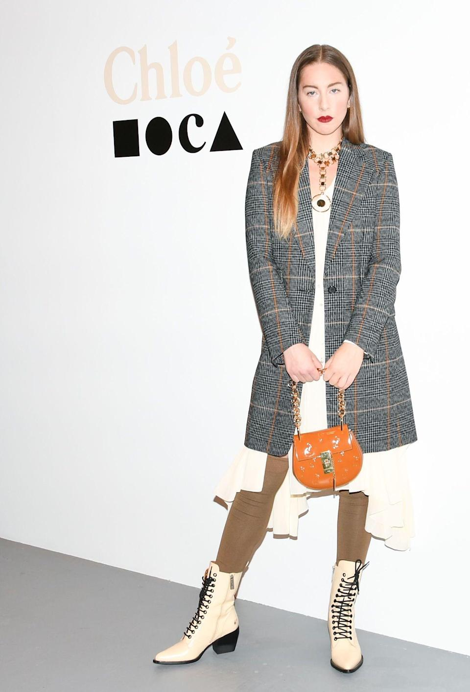 <p>We all have a favourite Haim twin and singer Este certainly delivered at Chloe's annual dinner in a head-to-toe look by the brand. Extra points for the winter berry lip… <em>[Photo: Getty]</em> </p>