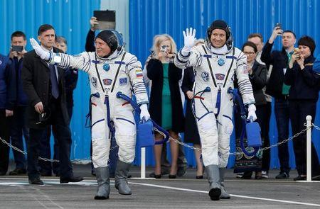 The International Space Station (ISS) crew members Jack Fischer of the U.S. (L) and Fyodor Yurchikhin of Russia walk after donning space suits shortly before their launch at the Baikonur cosmodrome, Kazakhstan April 20, 2017. REUTERS/Shamil Zhumatov
