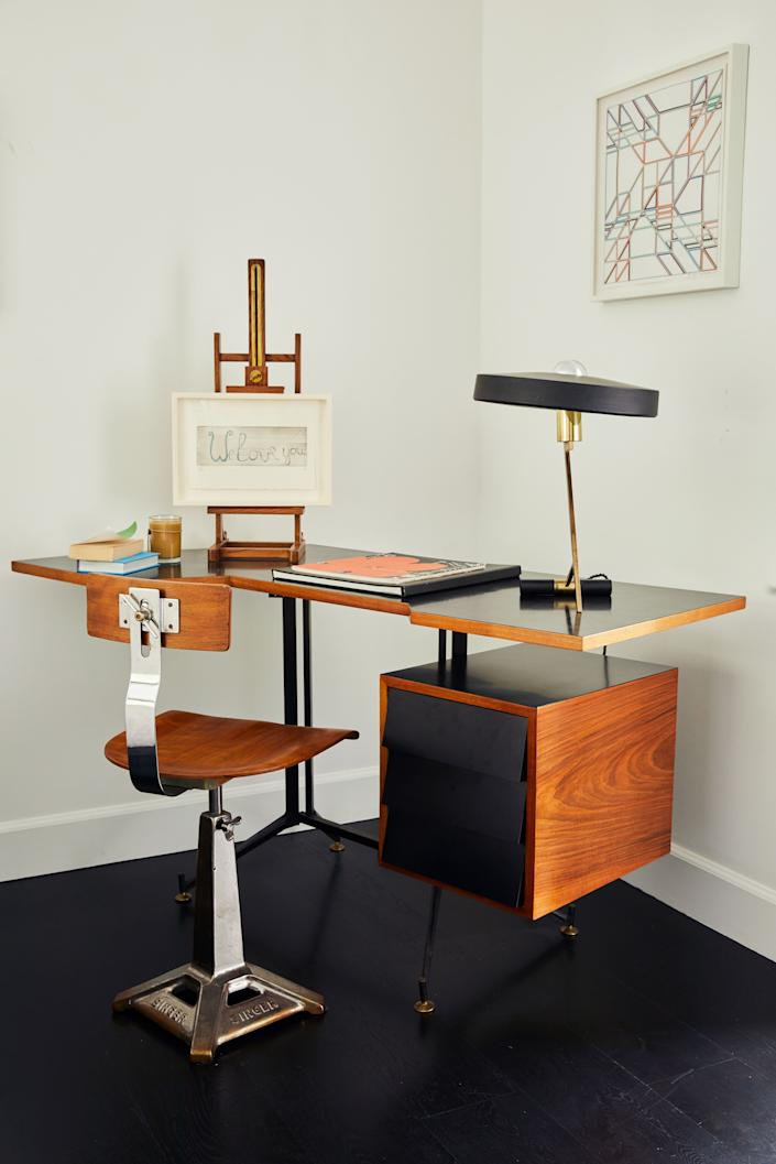 "<div class=""caption""> For a change, there are no Brazilian furnishings in this corner of the guest bedroom. The desk is a 1950s piece thought to be an original Gio Ponti (although the couple has not been able to confirm this) paired with a 1940s Singer sewing chair. On the easel is a Louise Bourgeois sketching titled <em>We Love You</em>. </div>"