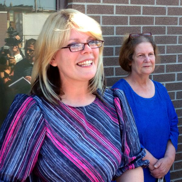 Kristine Bunch, left, with her mother Susan Hubbard, steps out of the Decatur County Sheriffs office after being released in Greensburg, Ind., Wednesday, Aug. 22, 2012, for the first time after 16 years in prison. Bunch was convicted of setting a 1995 fire that killed her 3-year-old son, but is free on bail as she awaits a new trial. (AP Photo/The Indianapolis Star, Charlie Nye) NO SALES