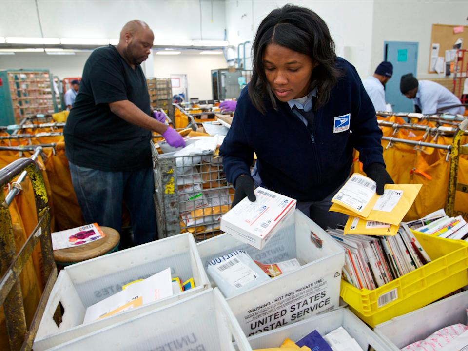 United States Postal Service clerks sort mail at the USPS
