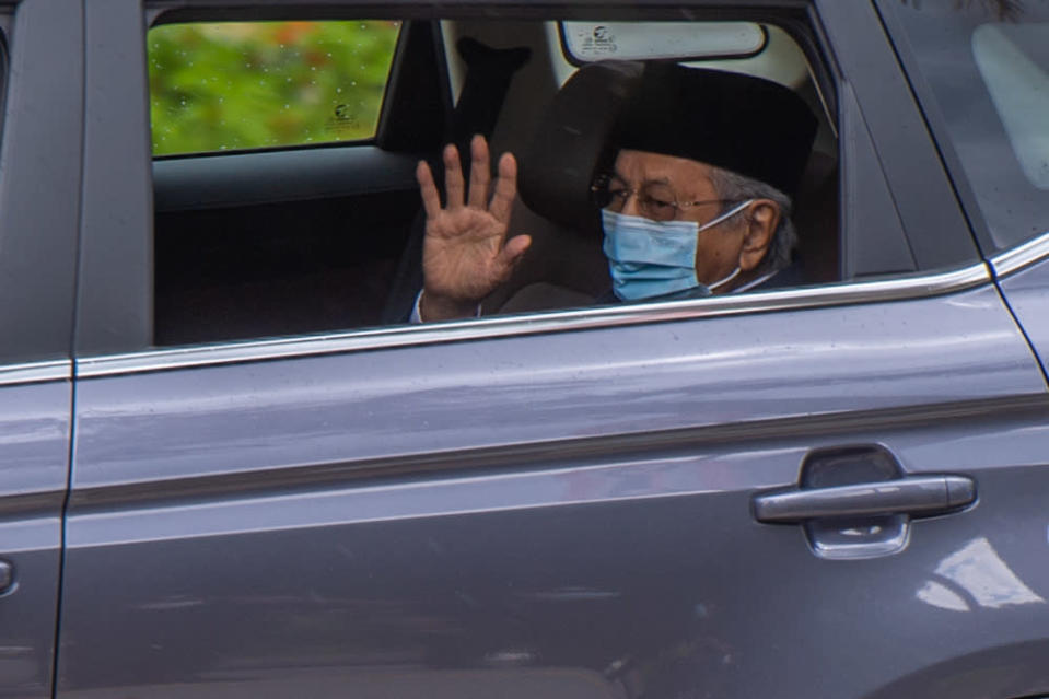 Tun Dr Mahathir Mohamad waves at members of the media as he leaves Istana Negara in Kuala Lumpur June 10, 2021.  — Picture by Yusof Mat Isa