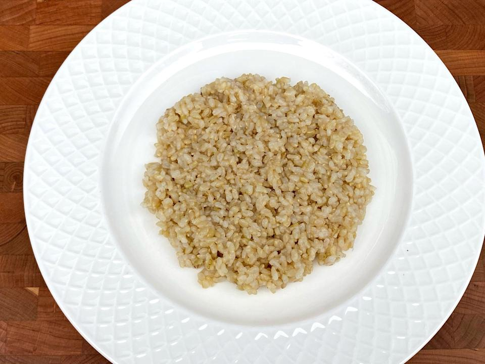 <p>2/3 cup of uncooked short-grain brown rice or 1 cup of cooked short-grain brown rice</p>