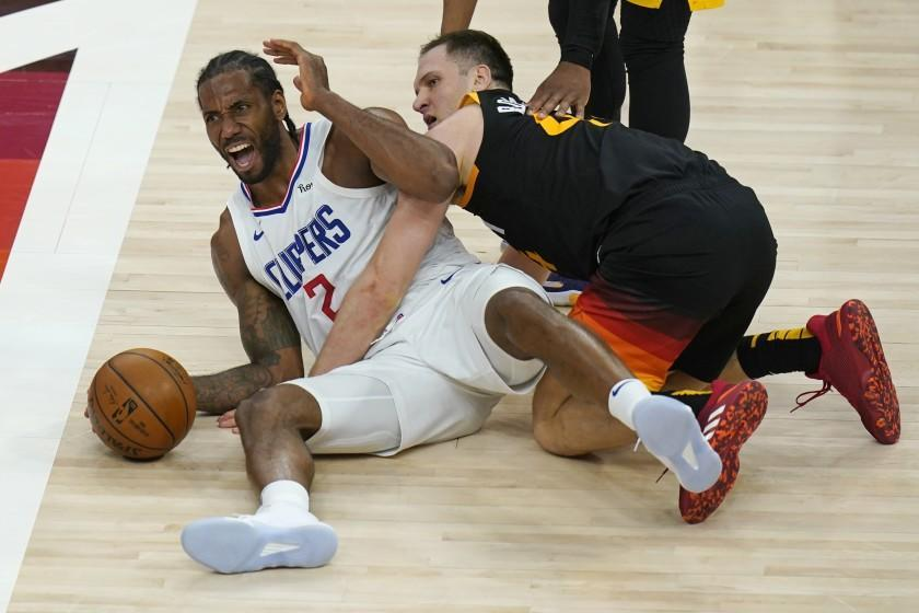 Los Angeles Clippers forward Kawhi Leonard (2) reacts after battling for a loose ball with Utah Jazz forward Bojan Bogdanovic, right, during the second half of Game 2 of a second-round NBA basketball playoff series Thursday, June 10, 2021, in Salt Lake City. (AP Photo/Rick Bowmer)