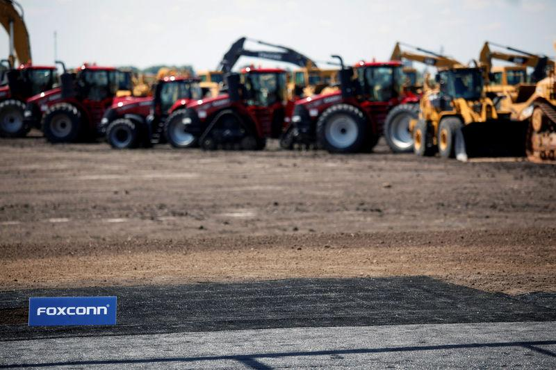 FILE PHOTO - Heavy machinery is seen before the arrival of U.S. President Donald Trump for the Foxconn Technology Group groundbreaking ceremony in Mount Pleasant